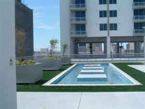 Artificial Grass from FieldTurf around Rooftop Reflecting Pool is beautiful, durable and virtually maintenance free.