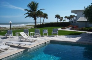 Beachfront residential pool area with FieldTurf grass. Impervious to salt spray, clean and soft near the pool and deck.