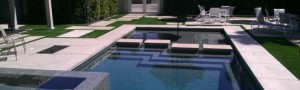 Community common area around pool with FieldTurf synthetic lawn. Feels real, looks real and durable.