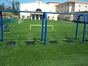 FieldTurf Playground Grass Surface at Divine Savior Academy in Doral with Heavy Duty Pads under the swings.