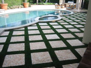 FieldTurf Grass Strips between Pavers in Pool Deck. Beautiful appearance, with virtually no maintenance.