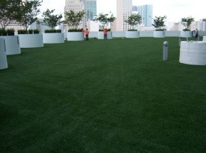 FieldTurf synthetic lawn on Roof with big live tree planters. The perfect Green Roof rooftop combination.