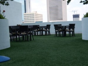 FieldTurf outdoor rooftop artificial grass seating area. It's functional and beautiful.