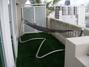 FieldTurf synthetic grass on condo terraces or balconies create comfortable, durable, realistic looking and feeling gardent areas.