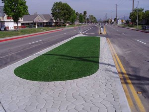 Synthetic grass from FieldTurf on median strip of neighborhood street