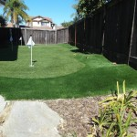 Residential side yard golf putting green with FieldTurf artificial grass.