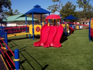 Kids Playground Area with FieldTurf Artificial Grass Surface making it clean, fun and safe.