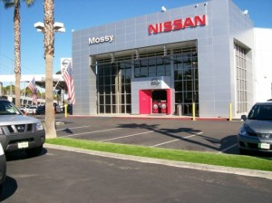 Nissan Auto Dealer with FieldTurf artificial grass medians in the parking lot.