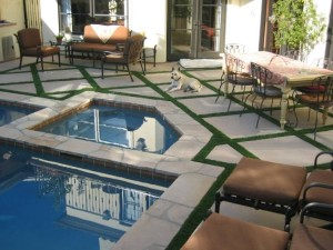 Pool Deck with FieldTurf grass strips between pavers. Artificial grass is ideal for this since it's durable, clean, looks real and feels real.