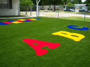 Litl Learning Center Auburndale with colored FieldTurf grass. We can create virtually any shape or design, in many different colors.