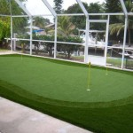 Residential Backyard Golf Putting Green inside a screened enclosure that you can use year round. Who needs a pool?