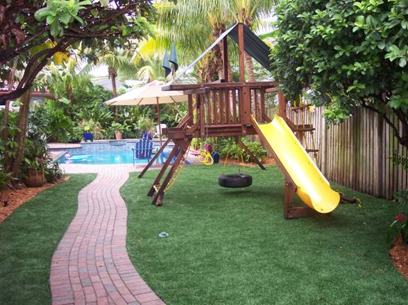 Residential Playground and Pool covered with our beautiful FieldTurf artificial grass.