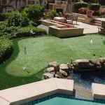 Residential Backyard Putting Green with 4 holes near Pool. Putting greens are installed with the highest quality and the most realistic backyard putting green surface and offers the longest life expectancy for endless practice that will shave strokes off your short-game.