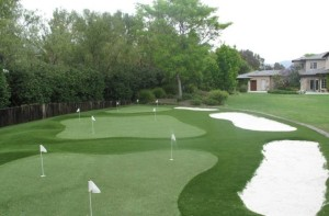 Residential Backyard with FieldTurf Putting Green. Each putting green is customized to meet your needs and fit in your desired space. No minimum and no maximum.