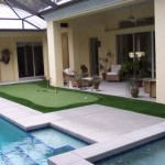 Golf Putting Green in a residential pool area inside a screened enclosure.