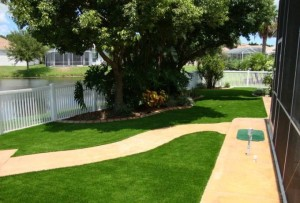 Residential backyard with artificial FieldTurf grass. Save water, save on maintenance. Great for pets and kids too.