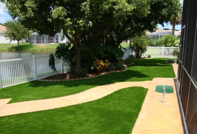 Backyard Turf Field : Residential backyard with artificial FieldTurf grass Save water, save