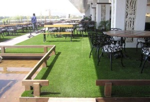 Rooftop seating area with FieldTurf artificial grass. Clean, Safe and Beautiful.