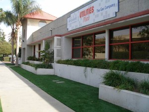 Storefront with FieldTurf artificial grass next to sidewalk