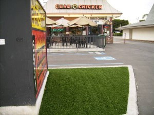 Storefront yard signage surrounded by FieldTurf artificial grass