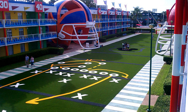 Disney All Stars Hotel with FieldTurf Artificial Turf Grass. Terrific example of our colored EASYTURF artificial grass capabilities.