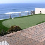 Waterfront Backyard Golf Putting Green with Artificial Grass. Not affected by salt or chemicals FieldTurf synthetic grass is perfect for pool and waterfront locations.