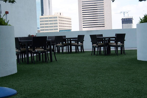 FieldTurf Outdoor Rooftop with Seating and Artificial Grass